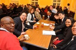 Image of people relaxing around a table
